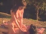Busty Nikki Dial rides a cock outdoors